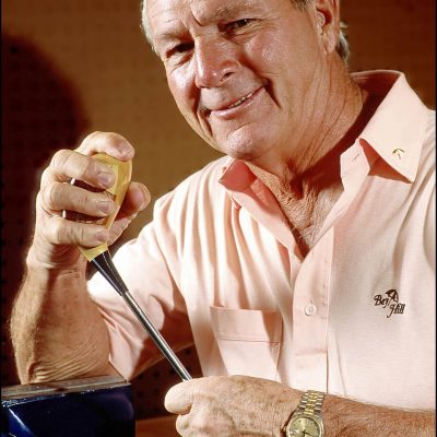 Arnold Palmer works with one of his golf clubs in his workshop in Orlando, Florida.