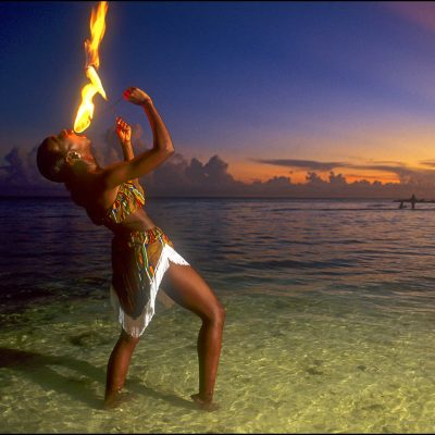 A Fire Eater performs in the waters off Grand Bahama Island at twilight.
