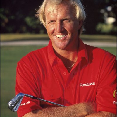Greg Norman jokes during a practice round of golf in North Palm Beach, Florida.